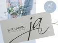 Hochzeitskarte WIR SAGEN JA in lichtgrau